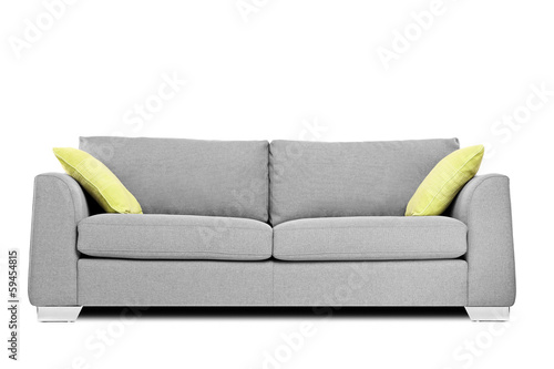 Studio shot of a modern couch with pillows - 59454815