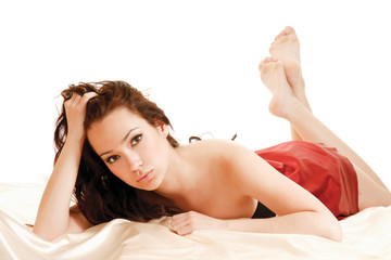 A beautiful girl lying on a bed