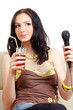 Young girl with cocktail singing karaoke
