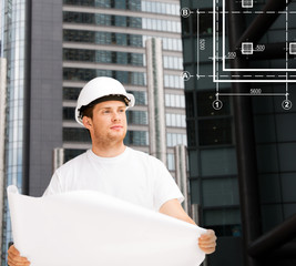 male architect in helmet looking at blueprint