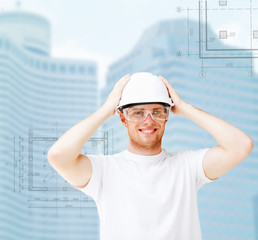 male architect in white helmet with safety glasses