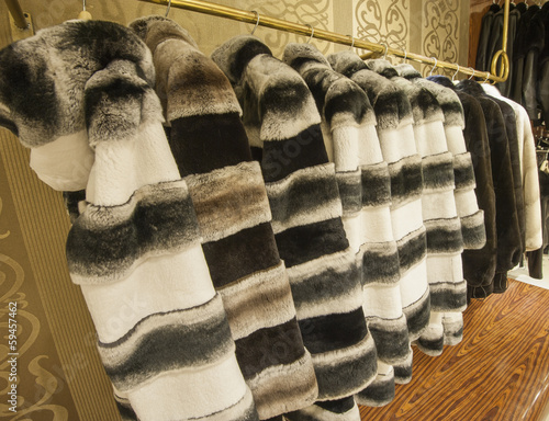 Fur coats hanging on a rail