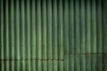 Green multi-tone grunge corrugated wall with character