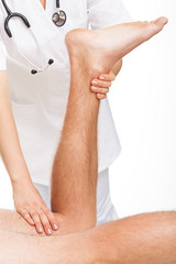 Orthopedist examining man's legs