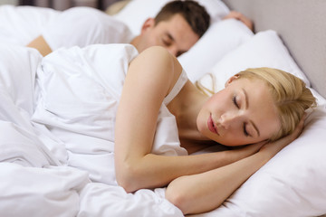 happy couple sleeping in bed