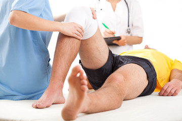 Medical team examining knee condition