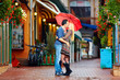 happy couple in love kissing on rainy street