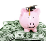 smiling piggy bank with graduation cap