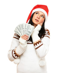 Portrait of beautiful woman wearing santa hat holding a money