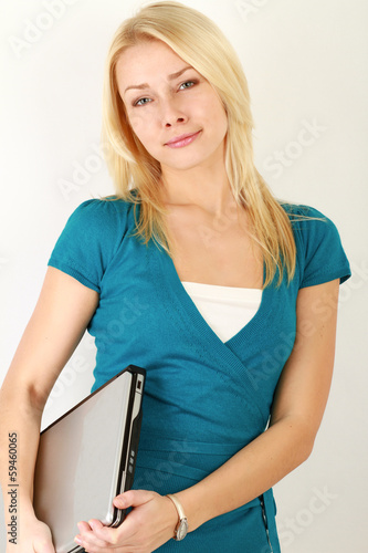 Young woman standing with folded arms