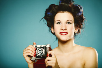 Pretty retro girl with vintage camera