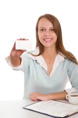 portrait of  young woman sitting at the desk and holding card