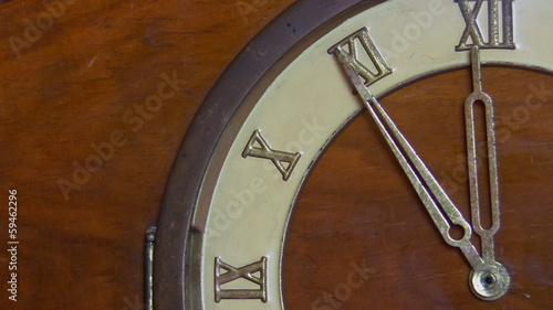 Retro clock with Roman numerals approaching twelve