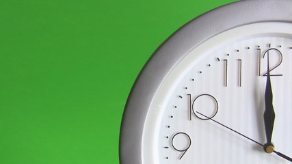 Electric clock isolated on green, last seconds to 12
