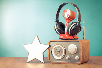 Retro radio, red microphone, headphones and win star