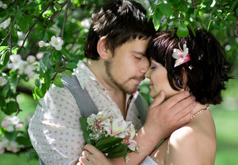 Romantic portrait of attractive young couple outdoors in nature
