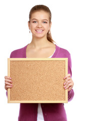 Young woman holding a board, isolated on white background.