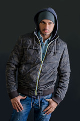 Trendy young man in winter clothes, studio shot