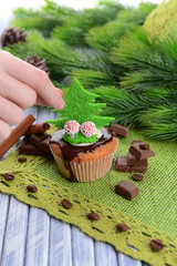 Tasty cupcake with butter cream, on color wooden background