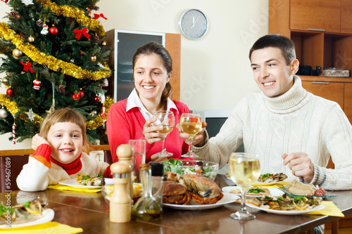Happy family of three over celebratory table
