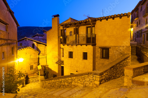 Narrow street of old spanish village in summer night
