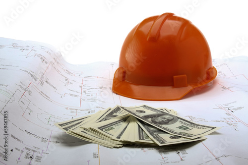 Construction blueprints and money.
