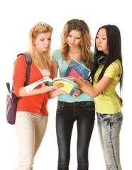 A group of young college girls standing with book