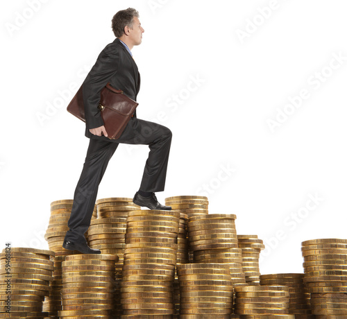 Businessman goes up coins