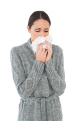 Casual young woman suffering from cold