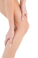 Close-up mid section of a fit woman with leg pain