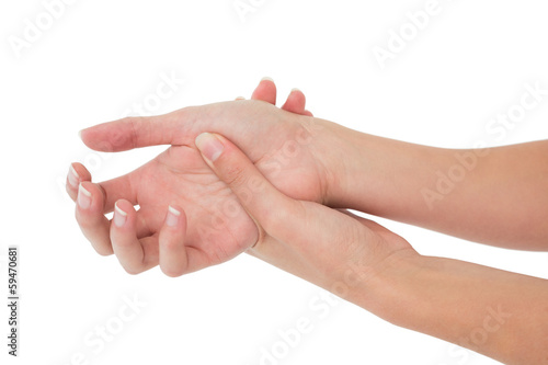 Close-up of a young woman touching her wrist