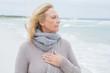 Contemplative casual senior woman at beach