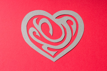 Paper Heart Shape with Ornament on Red Background