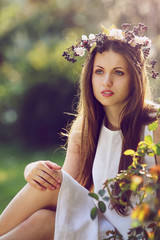 Portrait of a beautiful young woman in spring light