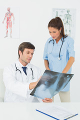 Doctors examining x-ray in medical office
