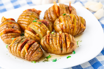 Accordion baked potatoes with bacon