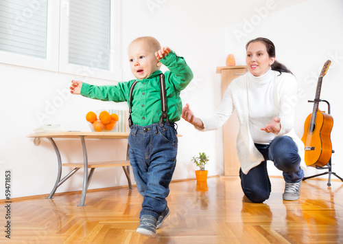 Cute smiling baby boy learning to walk
