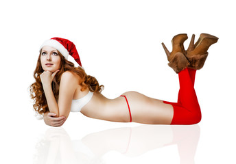 Sexy christmas girl in red santa claus hat