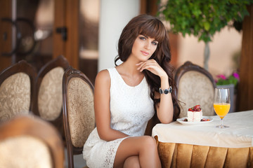 beautiful woman in cafe restaurant summer lifestyle portrait