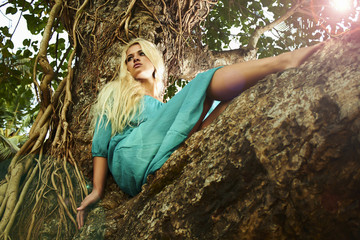 beautiful Girl on the tree. beauty Blond Woman in Jungle.summer