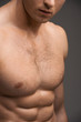 Close up of a nude man muscular chest.