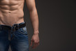 Close up of Sexy muscular man in jeans and nude torso.