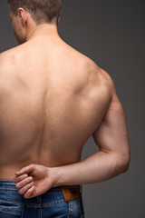 Close up of sexy male nude muscular back.