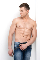 Sexy shirtless macho posing on camera and looking away