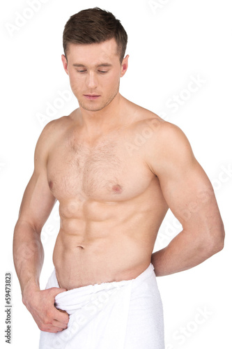 Sexy fit nude man in white towel.