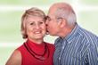 Senior man kisses his wife