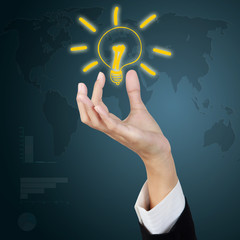 Business hand holding light bulb as creative concept