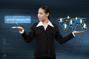 Business woman showing virtual screen the global community conce