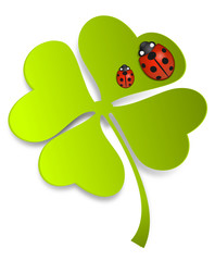 Grünes Kleeblatt mit Marienkäfern