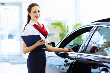 Woman consultant at car salon